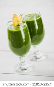 Green smoothie with kale, banana, ginger and water.