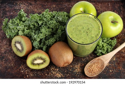 Green smoothie made with kale, kiwi, green apples and ground flax seeds