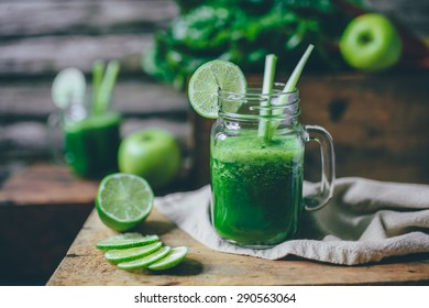 Green smoothie on a wooden background