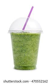 Green smoothie in plastic transparent cup isolated on white background