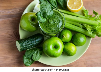 Green Smoothie and some Fresh ingredients: apples, cucumber, spinach, celery, bananas, milk, lime and lemon with Honey and Green Tea.