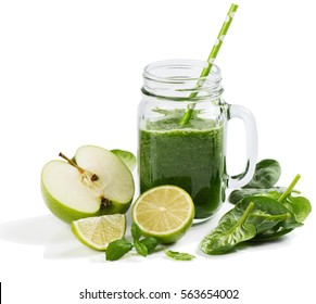 Green smoothie with  spinach, apple, lime and mint isolated in a jar mug on white background.