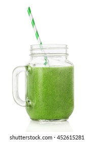 Green smoothies in a glass jar, a cocktail stick isolated on white background, healthy eating concept