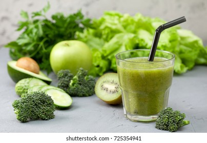green smoothies in glassful with fresh vegetables and herbs: broccoli, avocado, lime, celery, apple, kiwi, parsley. detox smoothies
