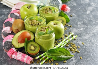 Green smoothies on a gray background