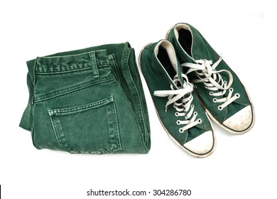 Green sneaker and green jeans isolated on white