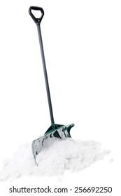 A green snow shovel standing upright in a small pile of snow.  On a white background.