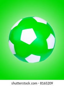 A green soccer ball set on a green background with a white gradient behind it.
