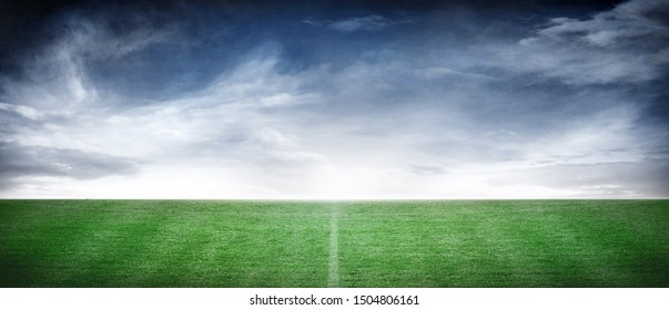 Green Soccer Field Grass Floor Background with Dramatic Panoramic Sky