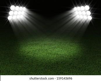 Green Soccer Field Illuminated by Spotlights