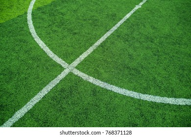 Green soccer field with white circle line, Flat lay