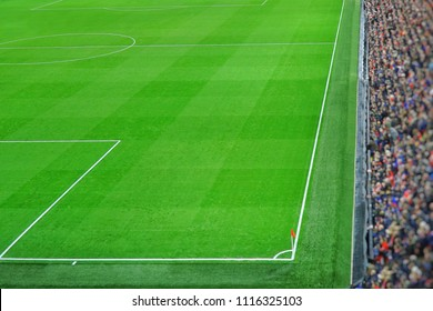 Green soccer field.Beautiful grass on the stadium.Abstract football ground background with white stripe line and red flag on the corner.Background,Sport,Athlete,People  Concept.Anfield,Liverpool