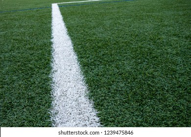 Green soccor European football astroturf with field markings and stripes