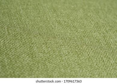 Green soft cotton fabric detail closeup macro texture background