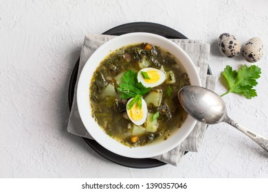 Green Sorrel soup - a soup made from  broth, sorrel leaves, spinach,  eggs (hard boiled), potatoes, carrots, parsley root. Polish, Ukrainian, Belarusian, Russian, Jewish dish.