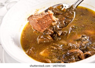 Green soup with beef and sorrel. Borsch