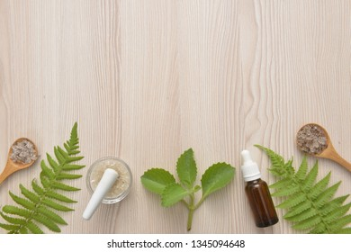 Green spa background, spa concept, natural herb essential from nature leaves and salt in spoon, oil