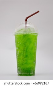 green sparkling water in plastic glass