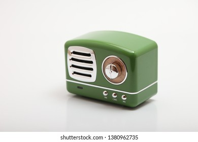 green speaker with metal grill on white background