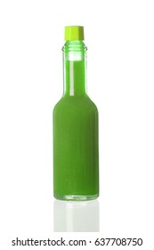 Green spicy sauce in a little bottle isolated on a white background