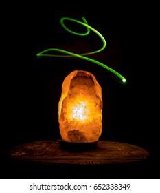 green spiral aura rising from salt rock crystal lamp