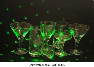 green spot light over the glasses