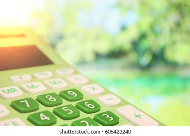 Green spring calculator on the leafs background