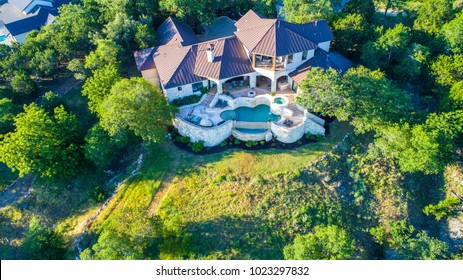 Green spring summer Luxury mansion on large lot of land with Texas hill country landscape and surrounding green surroundings of the ranch country home with infinity pool and wealthy real estate living