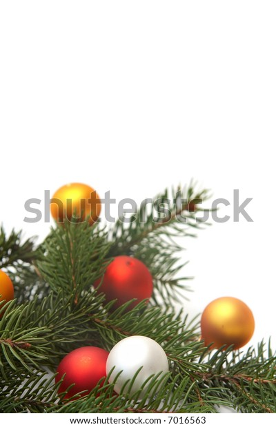 Green spruce branches with little colorful bulbs