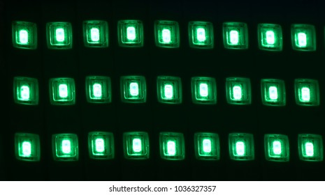 Green square shape small lights isolated electronics object stock photograph
