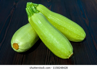 ЕTree green squash, courgette, zucchini, vegetable marrow on wooden table