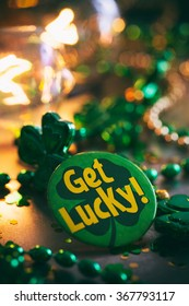 Green: St. Patrick's Button Sits On Confetti And Metal Background