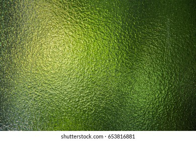 Green stained glass window texture.