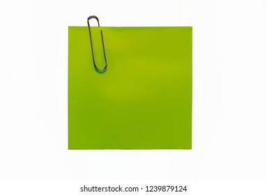 Green sticker note and steel paper clip on white background with clipping path.