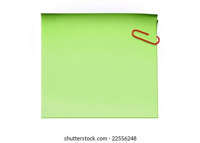 Green sticky note and paper clip