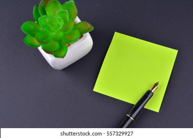 green sticky note with pen