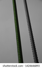 Green straight iron sticks with sky background photo