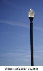 Green street lamp on a clear day