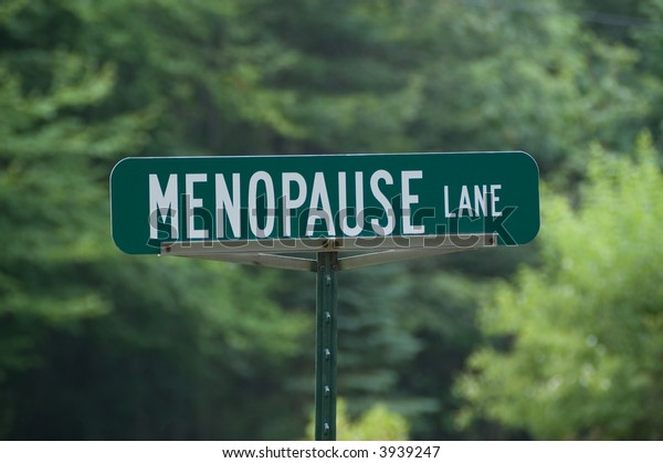 Green street sign with white letters for Menopause Lane