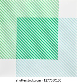 green striped paper on illuminated white background