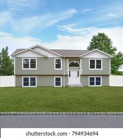 Green Suburban High Ranch home blue sky USA