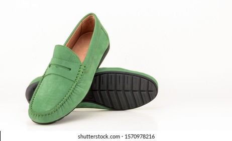 Green suede men moccasin isolated on white.