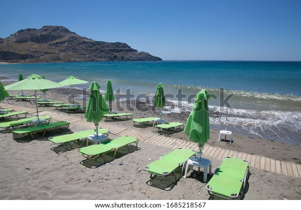 green-sun-beds-on-beach-600w-1685218567.