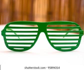 green sunglasses in retro style