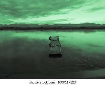 Green sunset and old fishing wooden pier and river on a background of mountains. Meditative relaxing natural landscape