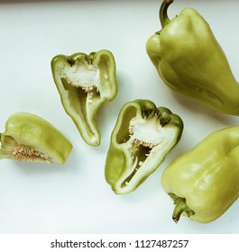 green sweet bell pepper isolated on white background. flat lay