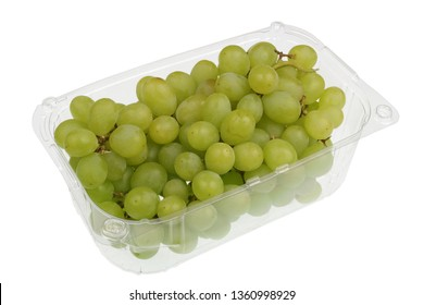 Green  sweet grapes berries  in a clear plastic container.Isolated with patch  studio macro shot