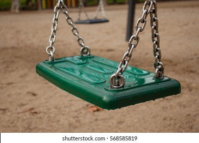 green swing isolated close up i the playground park