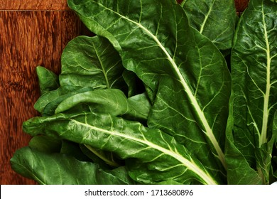 Green Swiss chard leaves with white veins macro. Healthy vegetables.