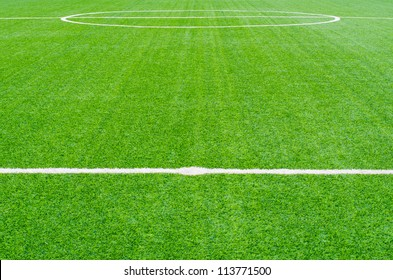 green synthetic grass sports field with white line  backgroubd
